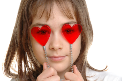 young girl with heart shaped glasses