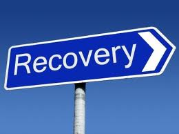 a street sign points to recovery