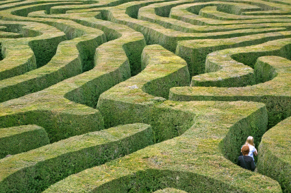 we see a cool green maze, as someone tries to solve the puzzle
