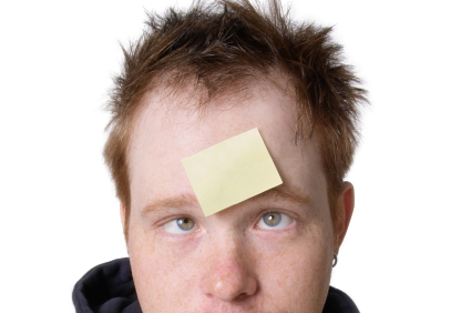 a man with a sticky note on his forehead