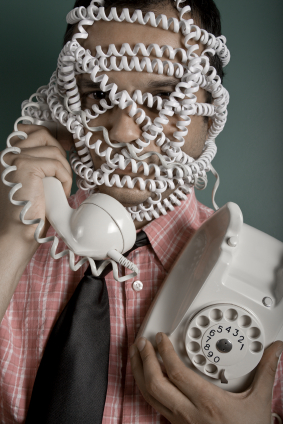 man tangled in a telephone cord