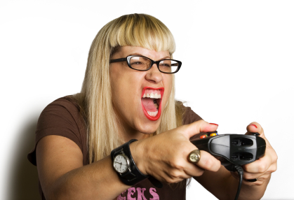 woman intensively engaged in a video game
